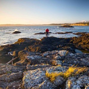 Man walking on beach rock | Vancouver Island Lifestyle
